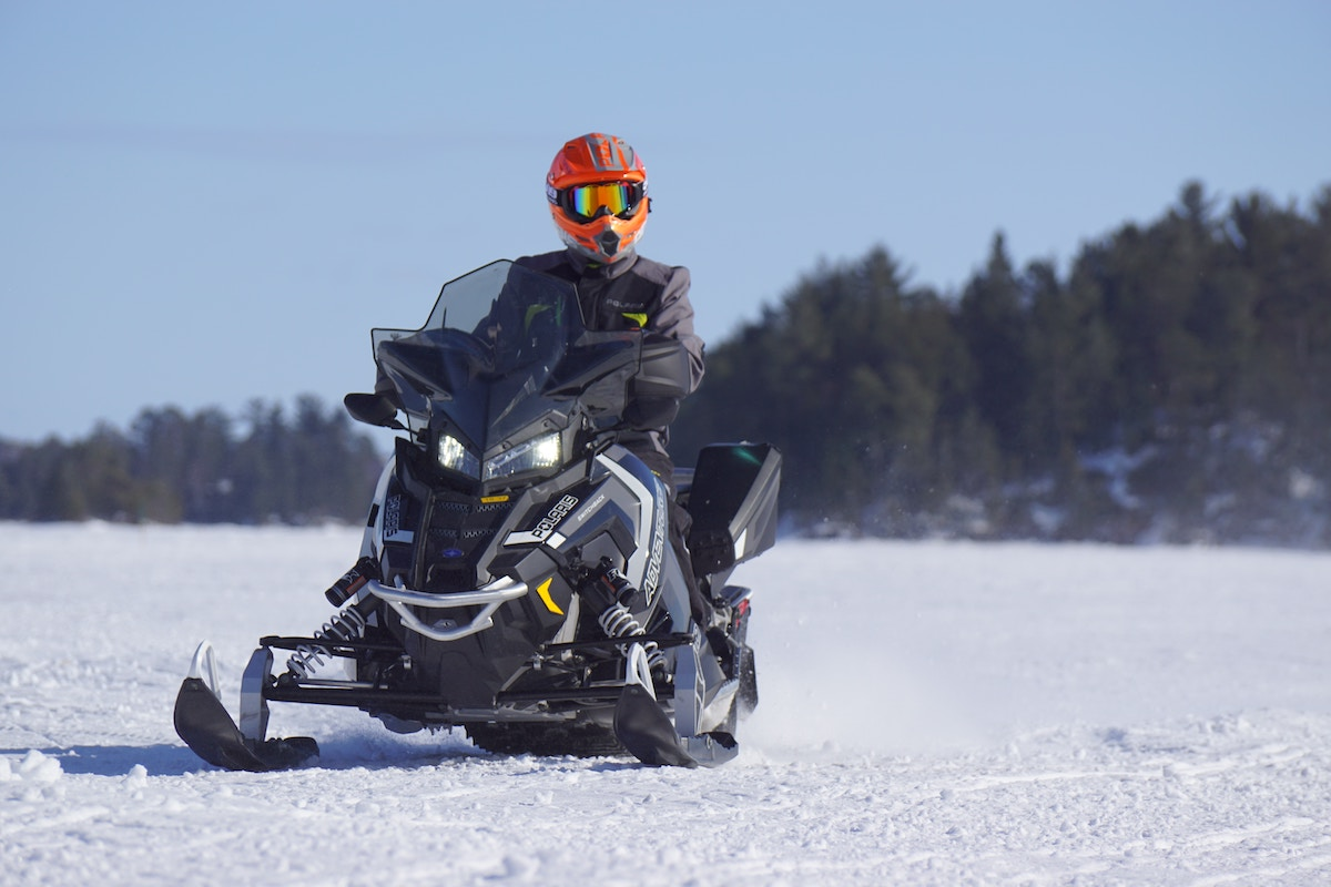 Snowmobile rider on a frozen lake.