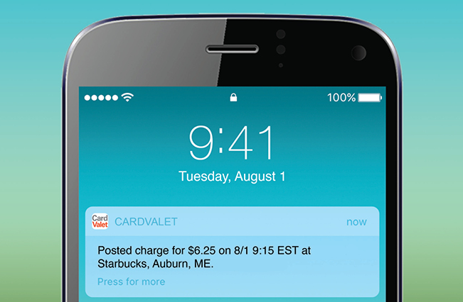 Smartphone displaying CardValet debit card alert on screen